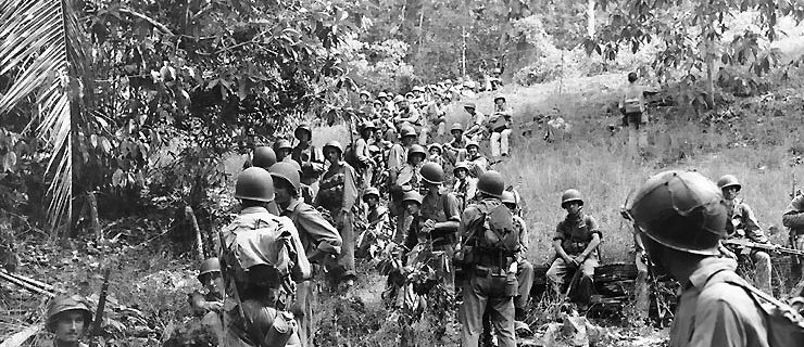 Marines rest in the field on Guadalcanal (photo via wikipedia)